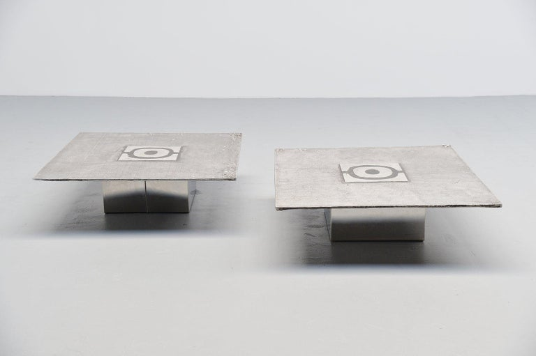 Very nice pair of artwork coffee tables made and designed by Willy Ceysens Neerpelt, Belgium, 1970. The tables are made of cast aluminium and have a chrome plated metal sheet base. Purchased in the beginning of the 1970s. The cast top features a