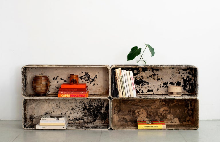Willy Guhl set of rectangular shaped concrete cubes. Fantastic patina - can be stacked to use as a bookcase / or used outdoors as a planter. Wonderful patina Priced and sold as a set of 4.
