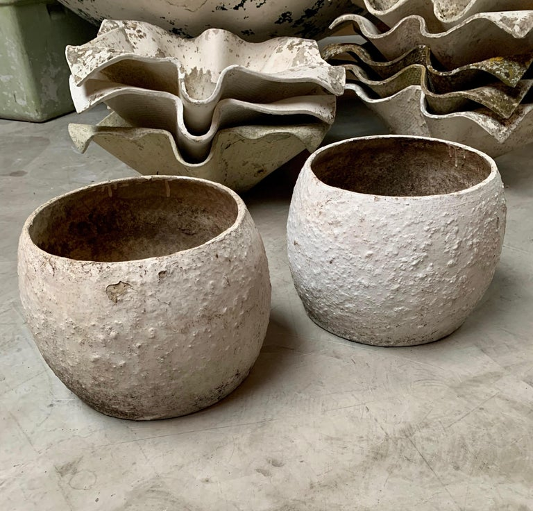 Unique set of concrete sculptures by Swiss architect Willy Guhl. Concrete vases/planters rarely seen. Cool sculptural piece for indoors or outside. Great standalone piece of art. Great vintage condition. Two available. Priced individually.