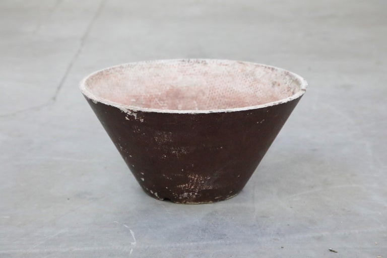 An incredible designer on-trend architectural concrete cone planter by Swiss architect Willy Guhl for Eternit, circa 1968 Switzerland. This cone shaped concrete planter has a patinated burgundy red exterior finish. Consider using this as a