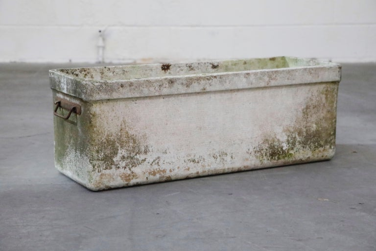 Incredibly gorgeous, this is a rare large rectangular planter with metal handles by Swiss architect Willy Guhl for Eternit, circa 1968, Switzerland.  The patina and age on this example is simply beautiful. For interior designers and collectors,