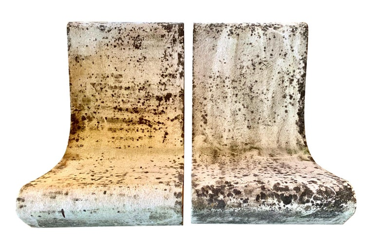 Fantastic pair of cement chairs by Swiss designer Willy Guhl for Eternit. One of the most iconic chairs ever designed. Very cool patina. Priced as a pair. 