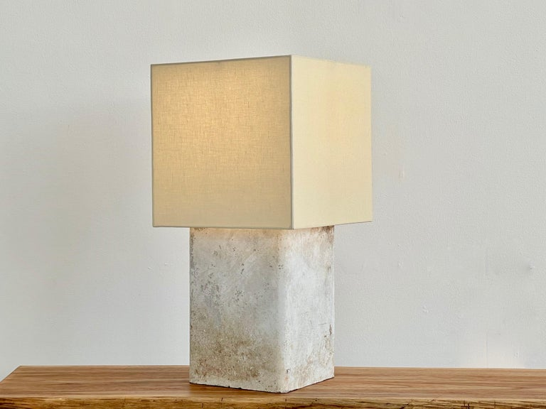 Willy Guhl concrete table lamp with linen shade  Priced individually.