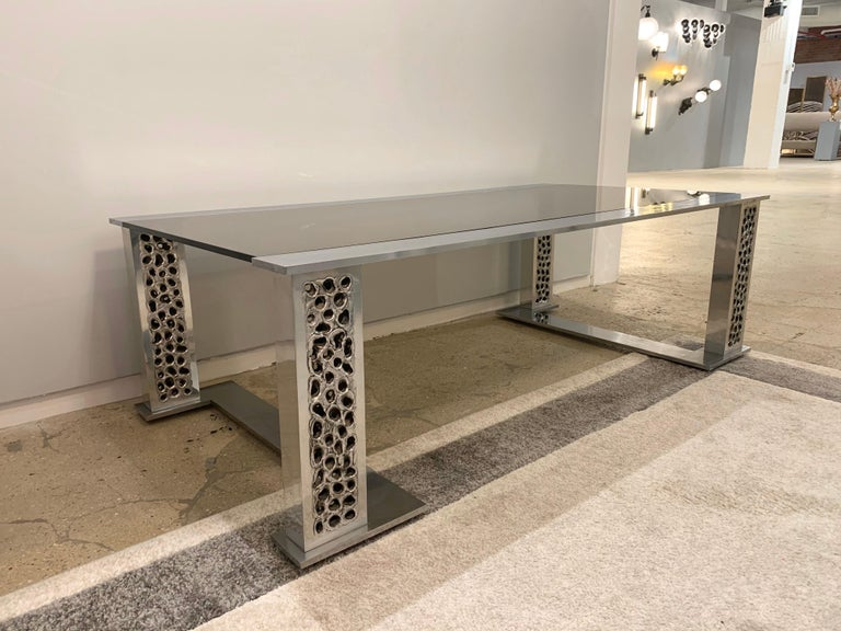 A rare original 1970s handmade burnt and hammered aluminum and smoked glass table by Belgian goldsmith, Willy Luyckx for Aluclair.   Willy Luyckx was a goldsmith who worked for goldsmith Camille Colruyt before starting his own business in the