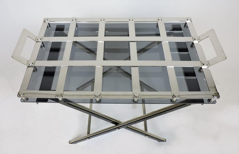 Handsome Willy Rizzo style butlers tray with stand, made of chrome-plated steel. The tray has a a gray Lucite bottom and the stand has black Lucite accents. The tray has two handles and grid openings to place glasses, and the stand can be folded.