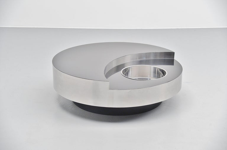 Spectacular 'TRG' revolving coffee table designed by Willy (William) Rizzo and manufactured by Studio Willy Rizzo, Italy, 1970. This is probably the nicest version of this table with a black laminated wooden top and stainless steel sides. With a