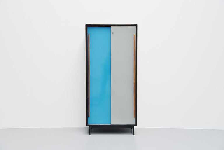 Nice modernist wardrobe designed by Willy Van Der Meeren and manufactured by Tubax, Belgium 1952. This wardrobe was actually designed for schools but are used for multiple purposes now. Very nice example of Belgian modernism designed by van der