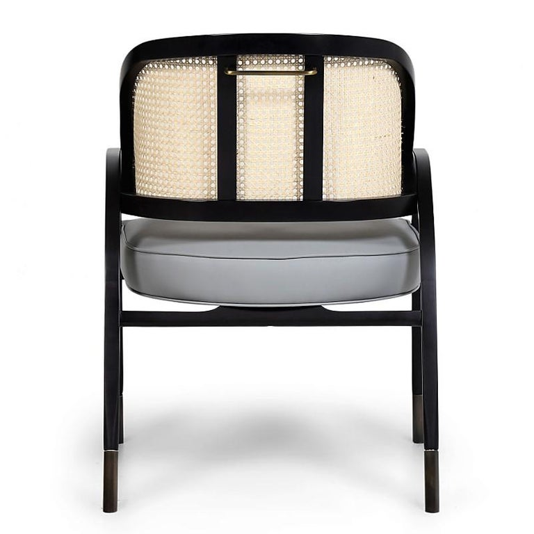 Woven Rattan and Solid Wood For Sale. Wilton contemporary dining   desk  chair is a modern version of the famous Captain armchair by 9244c4baced1f