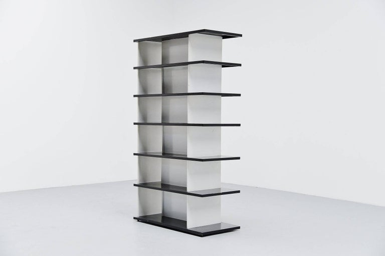 Very impressive bookcase or room divider designed by Industrial designer Wim Rietveld, son of Gerrit Rietveld. The origin of this bookcase was a big question, but it was made for exclusive department store De Bijenkorf in 1960. De Bijenkorf sold a