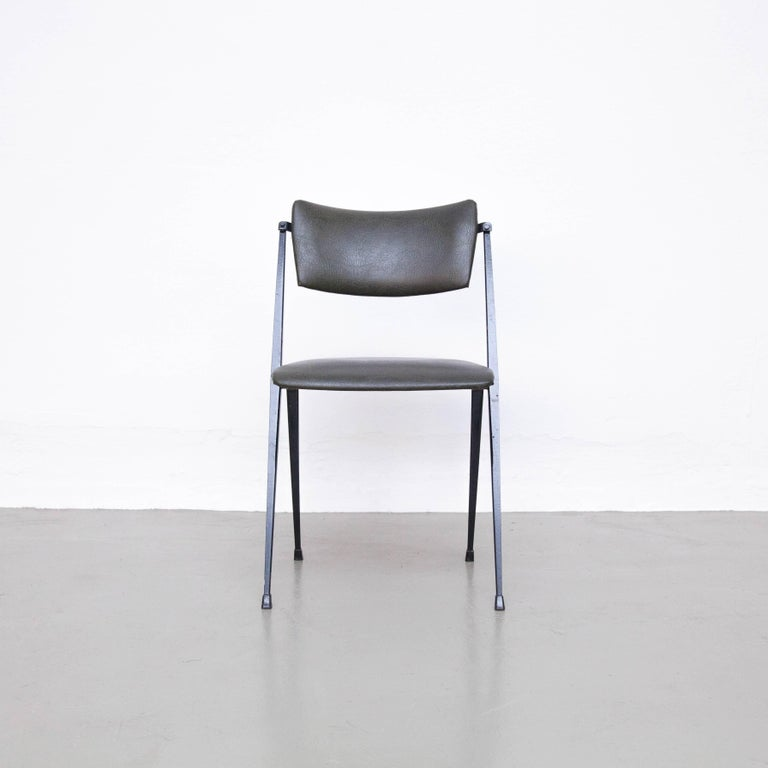 Pyramid chair by Wim Rietveld, circa 1960. Produced by Ahrend de Cirkel in Netherlands.  In good original condition with minor wear consistent with age and use, preserving a beautiful patina.  Wim Rietveld (1924-1985) is the youngest son of