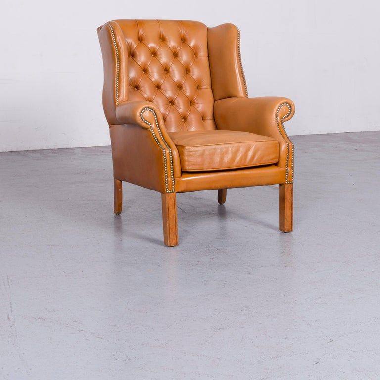 We bring to you a Windmill Chesterfield leather armchair set cognac one-seat vintage chair.