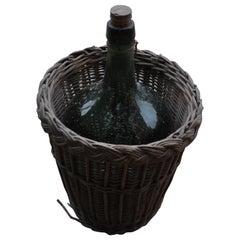 Wine Bottle and Basket, circa 1920
