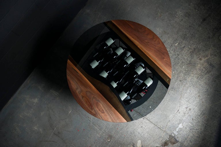 Our wine tasting and storage round table is handmade to order from an hand selected unique black walnut slab with an hand rubbed natural oil and wax finish that enhance the real beauty of the wood and give a natural warm touch. The seamless tinted