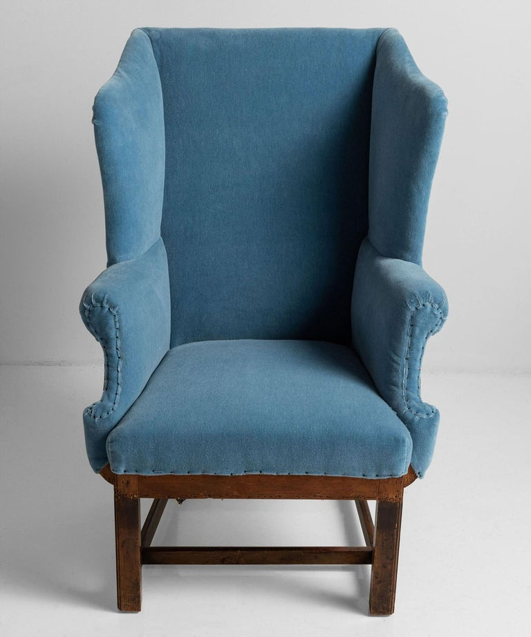 Newly upholstered in blue mohair velvet by Maharam with exposed sides and back.