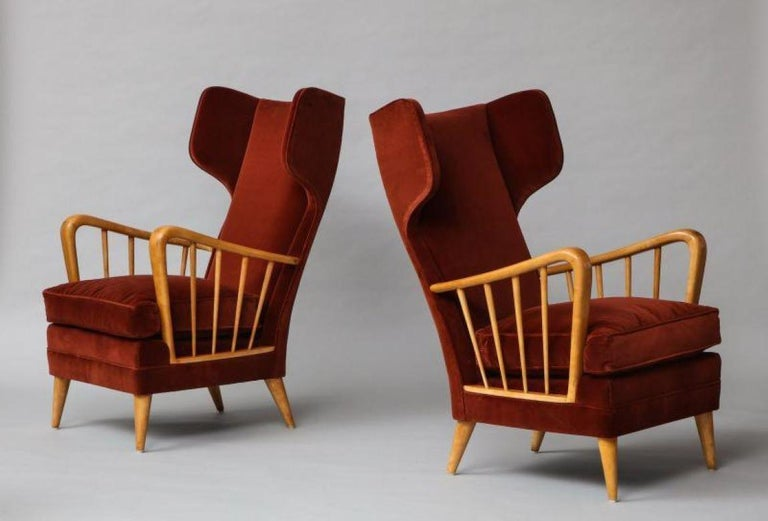 Wing Chairs, Model #6053B by Osvaldo Borsani for ABV.  A rare model with exaggerated wings forms. A pair of these chairs can be found in the main living room of the Villa Borsan, in Varedo, Italy. Maple & velvet upholstery. Provenance: Private