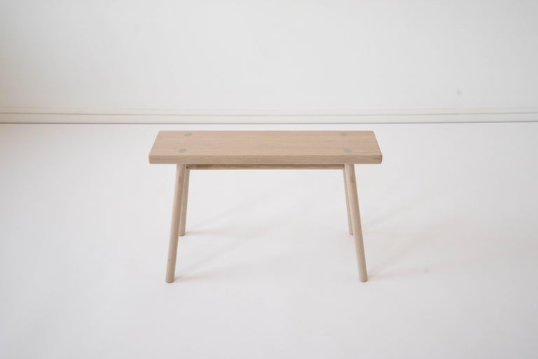 Sun at Six is a contemporary furniture design studio that works with traditional Chinese joinery masters to handcraft our pieces using traditional joinery. Handcrafted using traditional joinery. Designed at a size that allows this stool to serve as