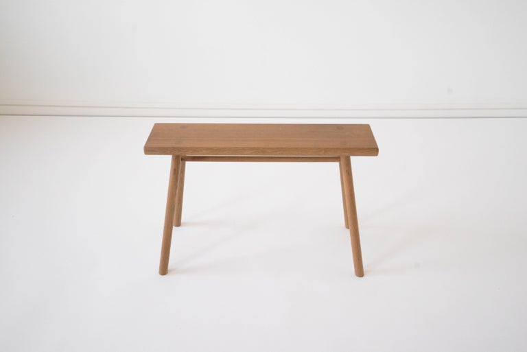 Sun at Six is a Brooklyn design studio. We work with traditional Chinese joinery masters to handcraft our pieces using traditional joinery. Handcrafted using traditional joinery. Designed at a size that allows this stool to serve as a bench, side or