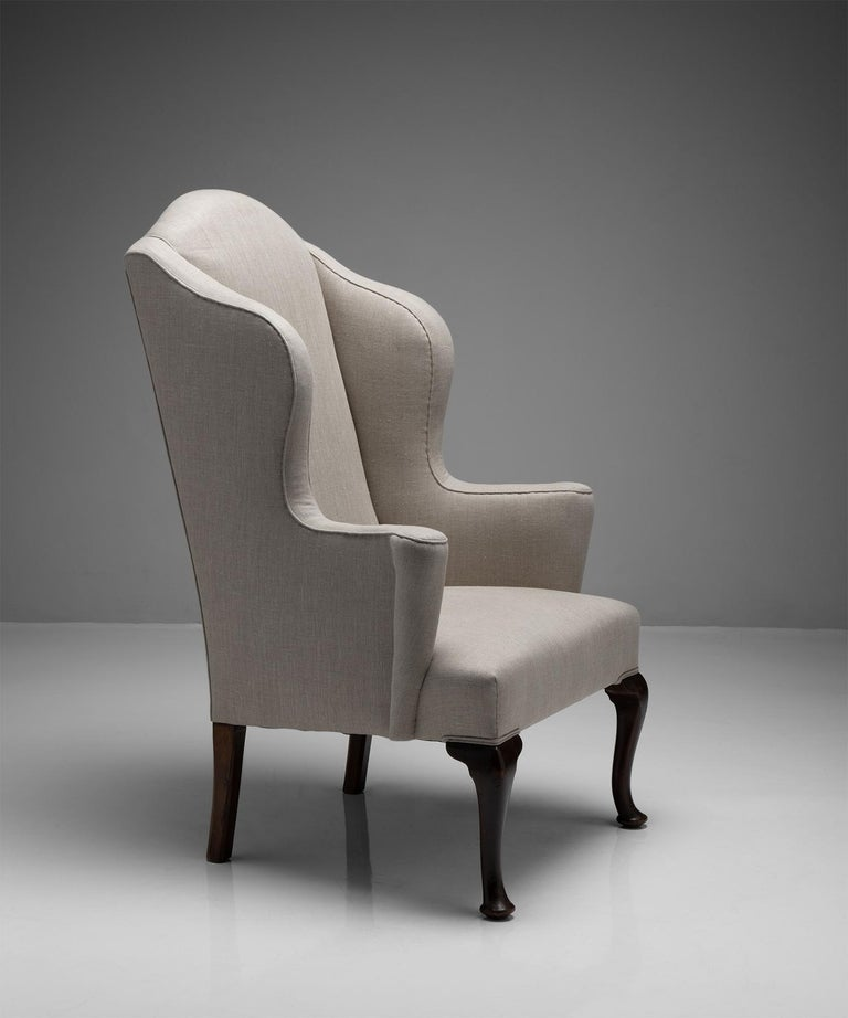 Wingback armchair  Newly upholstered with turned legs  England, Circa 1840.