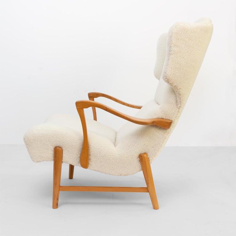 Carved Winged Back Scandinavian Modern Lounge Chair in Faux Sheepskin Fabric