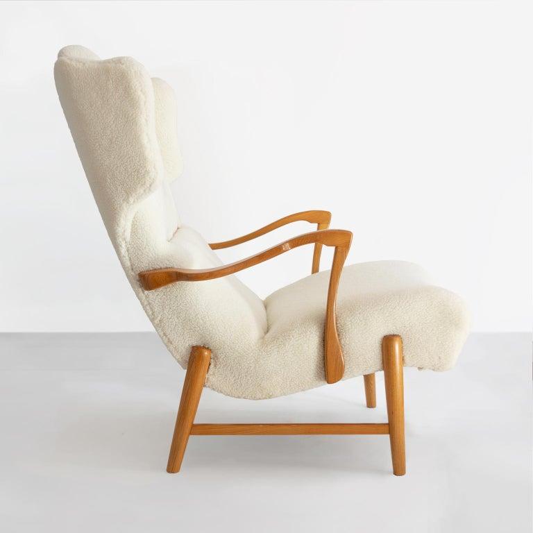 Beech Winged Back Scandinavian Modern Lounge Chair in Faux Sheepskin Fabric