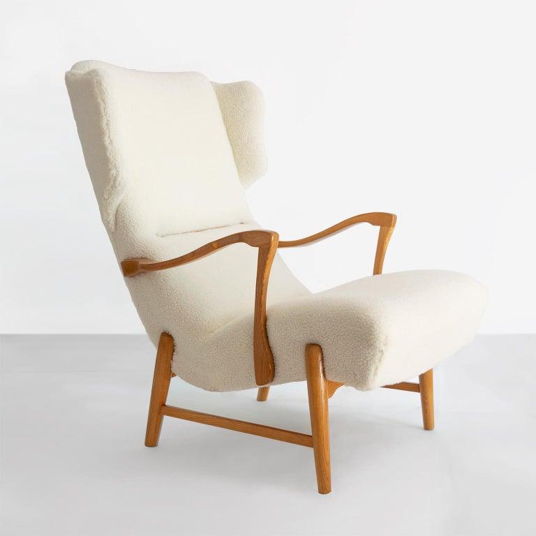 Winged Back Scandinavian Modern Lounge Chair in Faux Sheepskin Fabric 1