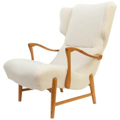 Winged Back Scandinavian Modern Lounge Chair in Faux Sheepskin Fabric