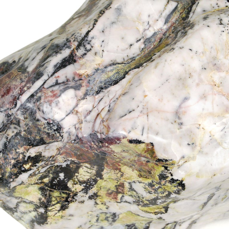 Unearthed in Jiangsu province, this gorgeous stone has been polished to reveal the full array of its soft colors and intriguing patterns. Prized by collectors for centuries, such stones were especially sought after by Chinese scholars who plumbed