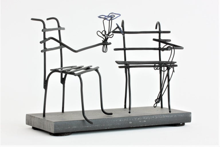 Hammered iron wire sculpture with steel stand. Laure Simoneau's creation 'First Date' is a whimsical depiction of two chairs exchanging tokens of love. Her sculptures follow in the footsteps of Alexander Calder, creating substance out of nothing: