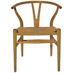 Wishbone Chair, Model CH24, in Ash by Hans J. Wegner and Carl Hansen and Son