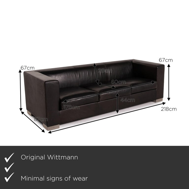 We present to you a Wittmann Camin leather sofa black three-seater couch.