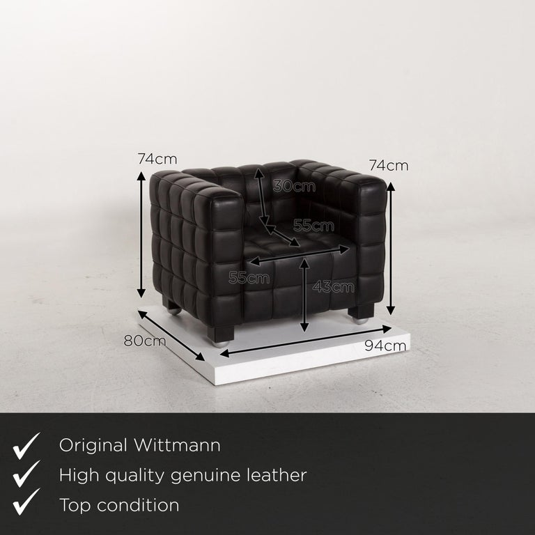 We present to you a Wittmann Kubus leather armchair black.