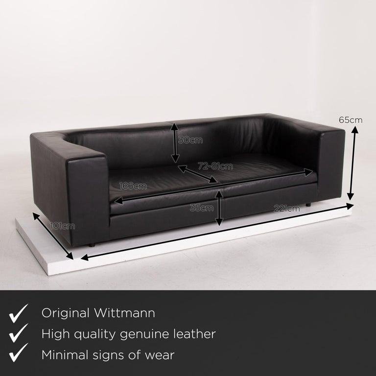 We present to you a Wittmann leather sofa black three-seat.      Product measurements in centimeters:    Depth 101 Width 221 Height 65 Seat height 35 Rest height 65 Seat depth 72 Seat width 166 Back height 30.