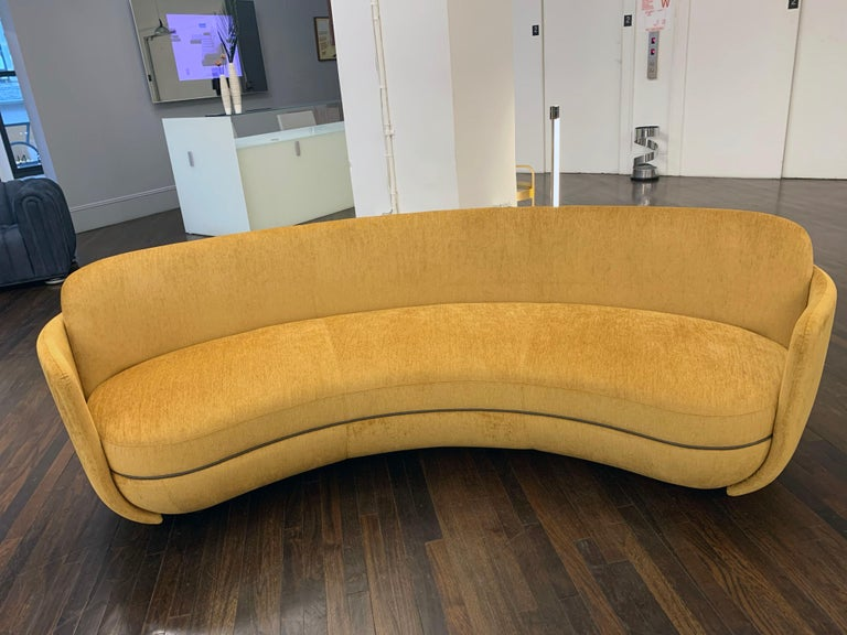 Cate Sevilla gold / Trim Nappa flint Soft, round, inviting, protective. Long gone are the days when formal sofa arrangements dominated living spaces. New and different - Miles ahead, in a manner of speaking. Measure: 236cm (92.9