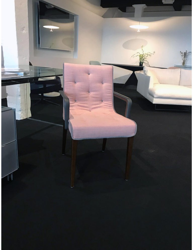 Leslie low back dining chair (Stitched) with arms Arms upholstered in nappa flint leather Chair upholstered in arena rose #S15KV0614 Piping and buttons in com COM: Designtex
