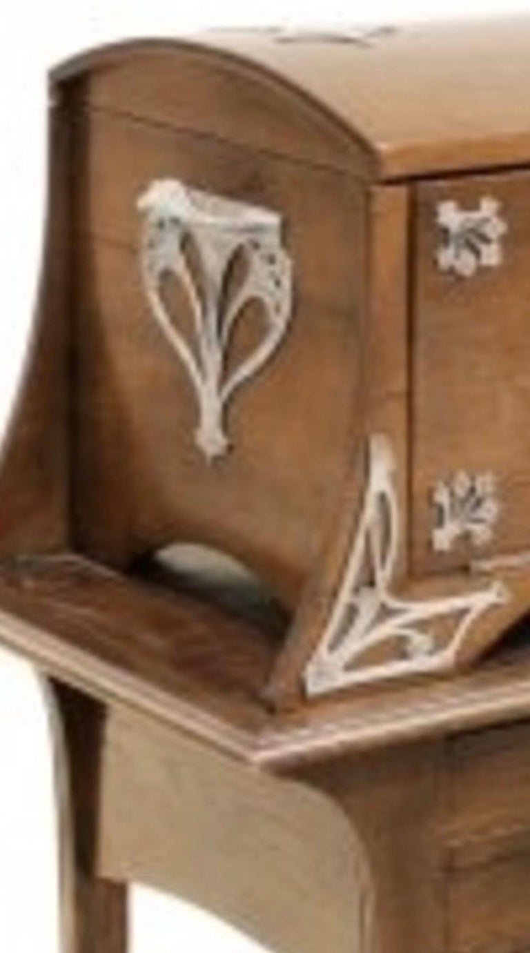 W.M.F. an Art Nouveau cutlery canteen, in oak case,  Early 20th century. The upper hinged casket with a fall front to reveal three fitted drawers, the lower section with a further two fitted drawers, the shaped legs joined by an undertier, the
