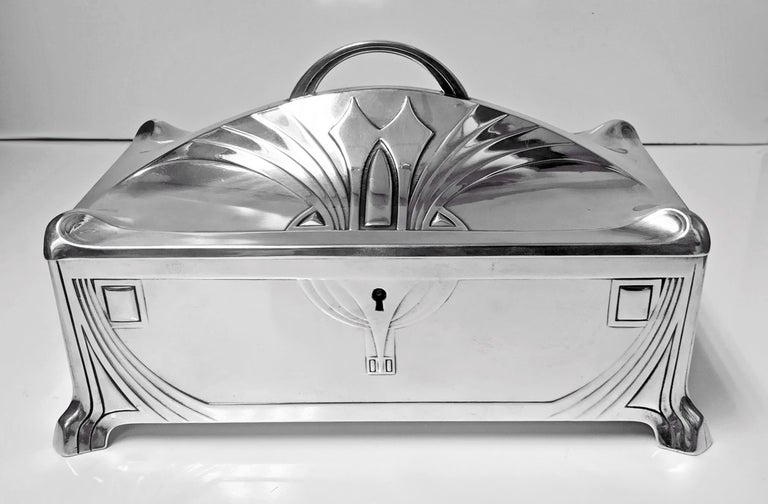 WMF Jugendstil Secessionist Silver plate large Jewellery or Cigar Box, Germany, C.1906. The box of rectangular shape on four turned stylised supports, conforming in style to cornices and decoration of sides and concave dome shape hinged cover with