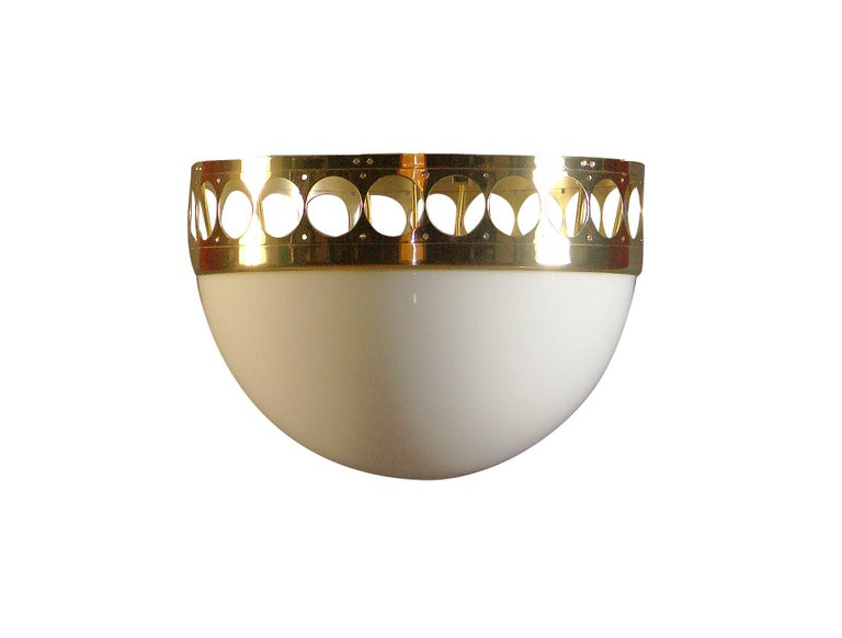 Pendant-lamp with a punched brass-rim and a hand blown opaline-glass, hanging on braided wires, decorated with brass-balls Total drop custom made All components according to the UL regulations, with an additional charge we will UL-list and label