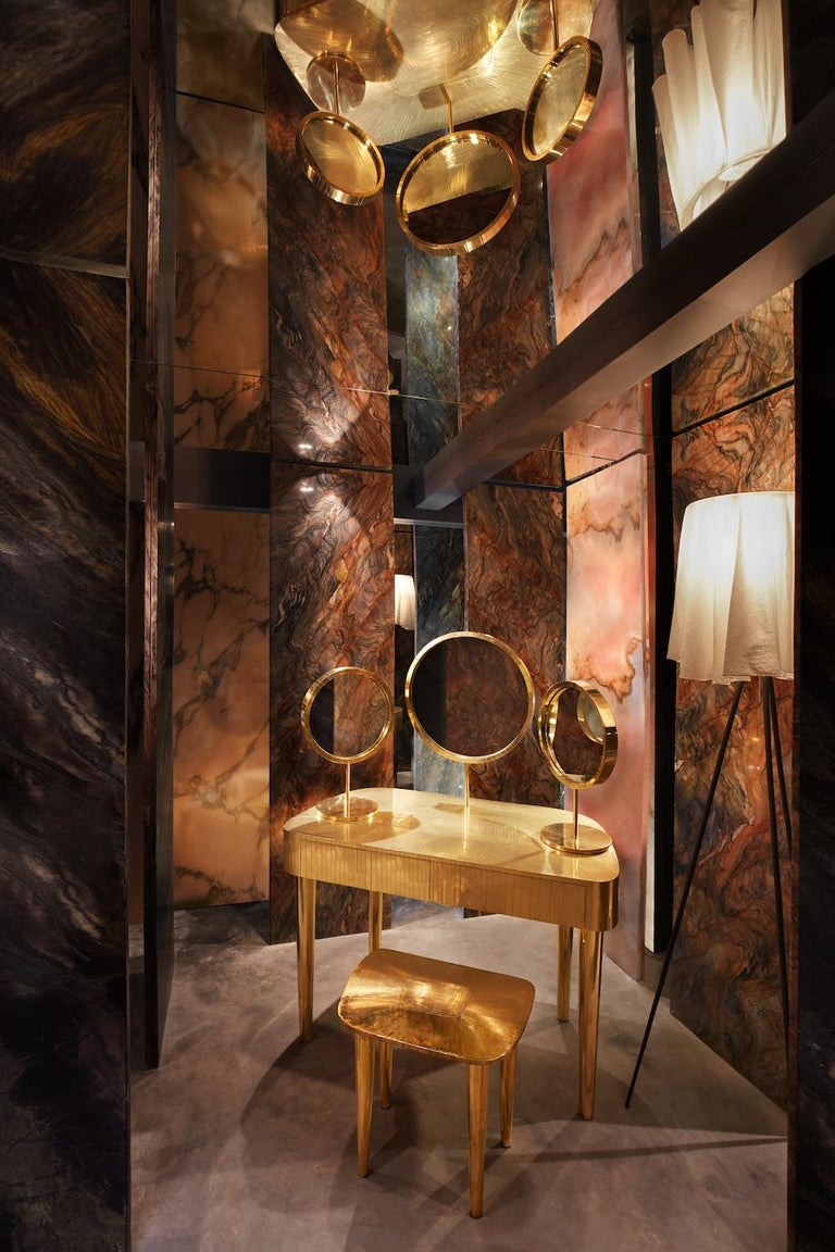 Woman in Paris Oro is an opulent vanity table with brass inlay. It has two drawers and three mirrors, two of which can be moved to desired angles.   Matteo Cibic designed the Vanilla Noir collection for Scarlet Splendour in 2014-15. The collection