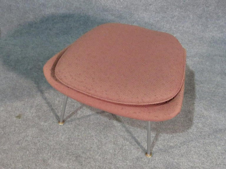 Eero Saarinen designed Womb chair and ottoman produced by Knoll. (Please confirm item location - NY or NJ - with dealer).