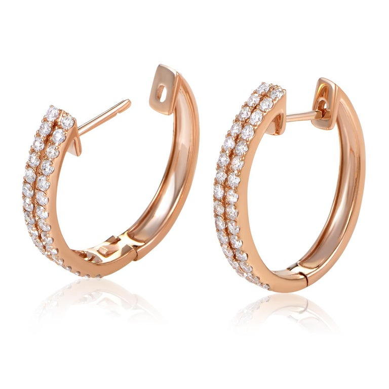 Gorgeous diamonds are the hallmark of this classic design. This pair of earrings are made of 14K rose gold and are paved with .96ct of white diamonds.