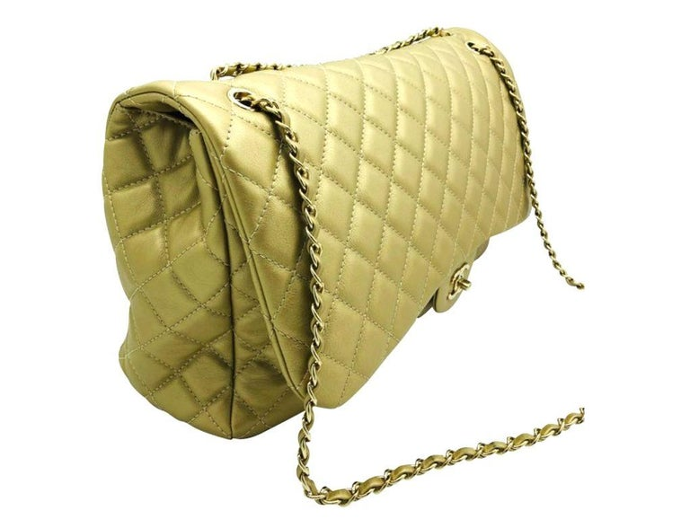 An absolutely stunning bag by Chanel for sale. This XXL Travel Flap bag in soft metallic gold calfskin leather is wonderful. A preloved item in very good condition.  BRAND Chanel  FEATURES CC Clasp Closure, One exterior slip pocket, One interior