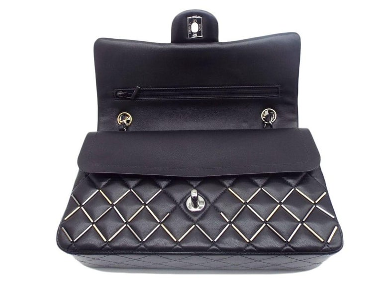 What a stunning beauty..! This Chanel Flap Bag is the iconic Chanel Classic Double Flap Bag in black lambskin, embellished with gold and silver beadwork. The bag has an interwoven leather chain strap which is two-toned in gold and silver. This bag