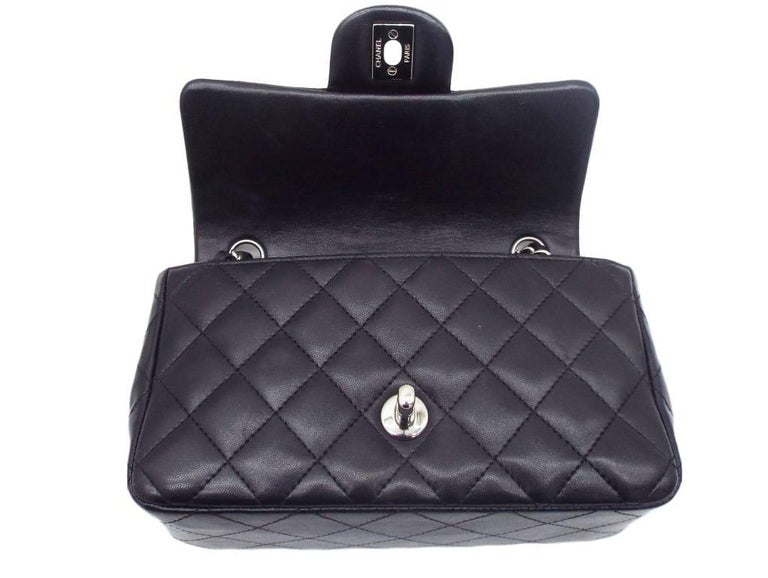Just stunning.! What is there not to like about this superb Chanel Mini Flap Shoulder bag with chain and leather strap. Sumptuous lambskin finished off with silver hardware. This bag is in excellent used, preloved condition with very minor scratches