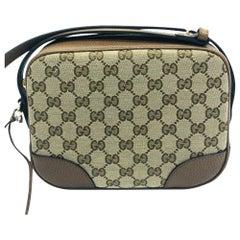 Womens Designer Gucci Bree Original GG Canvas Messenger bag