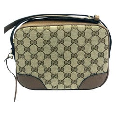 Womens Designer Gucci Bree Original GG Canvas Messenger bag
