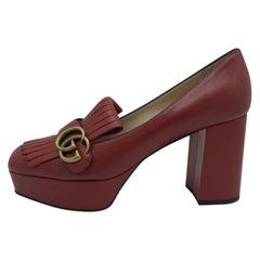Womens Designer Gucci Marmont fringed logo-embellished leather platform pumps