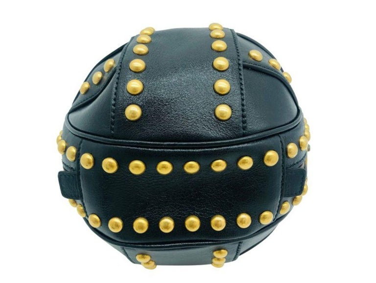 Exquisite ball design handbag. The Gucci Tifosa is made from black leather with gold studded detail throughout.  A new bag for sale.    BRAND Gucci  ACCESSORIES Care card, Dustcover  COLOUR Black  CONDITION New  FEATURES antique gold studs,