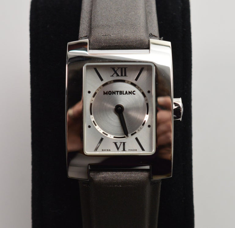 Contemporary Women's Montblanc Stainless Steel # 7047 Quartz  Profile Wrist Watch, in mint condition and in it's original box. The leather wristband is covered in an elegant slate fabric and measures eight inches including the head and is