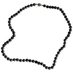 Women's Tahitian Black Pearl Necklace with a 14 Karat Gold Ball Clasp