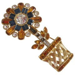Women's Valentino brooch with flower in coloured metal. Signed 1990s
